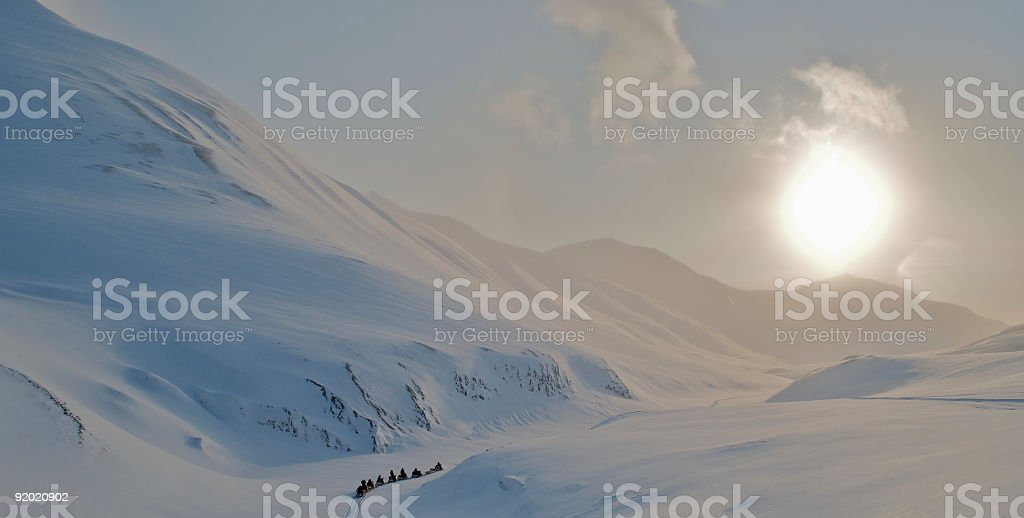 Arctic Expedition in Snow Terrain During Midnight Sun stock photo