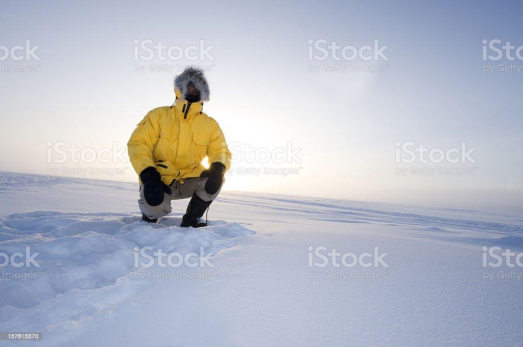 Arctic Fog.  Man in a Parka on the Snow stock photo