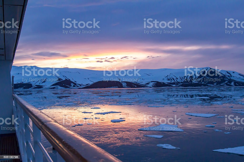 Arctic Glow reflecting in Whalers Bay, Deception Island, Antarct stock photo