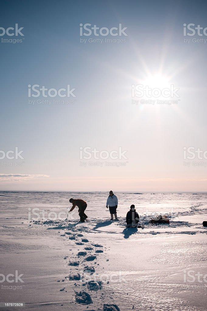 Arctic Ice Fishing, Yellowknife, Northwest Territories, Canada. stock photo