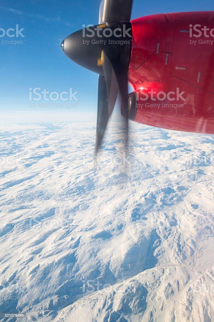 Arctic ice shield seen though an airplane window stock photo