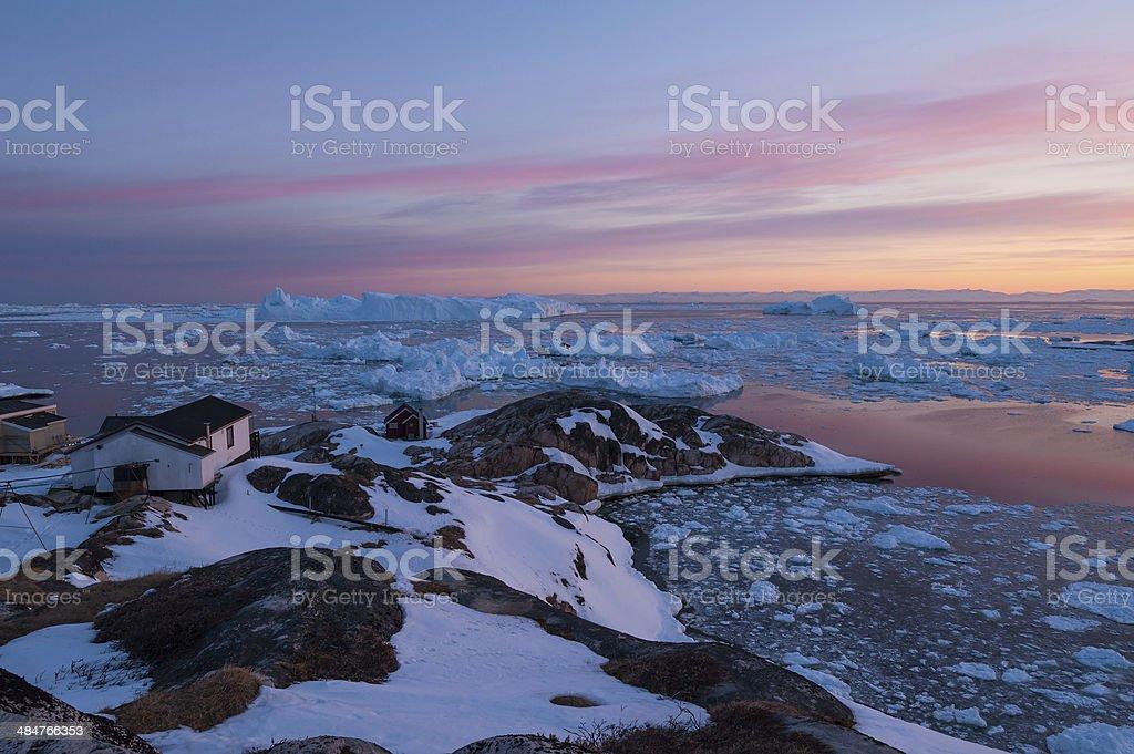 Arctic light at sunset in Ilulissat, Greenland stock photo