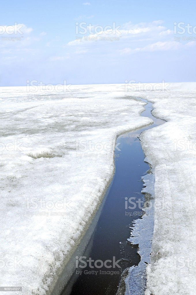 arctic solid ice landscape with track of ice-breaker ship stock photo