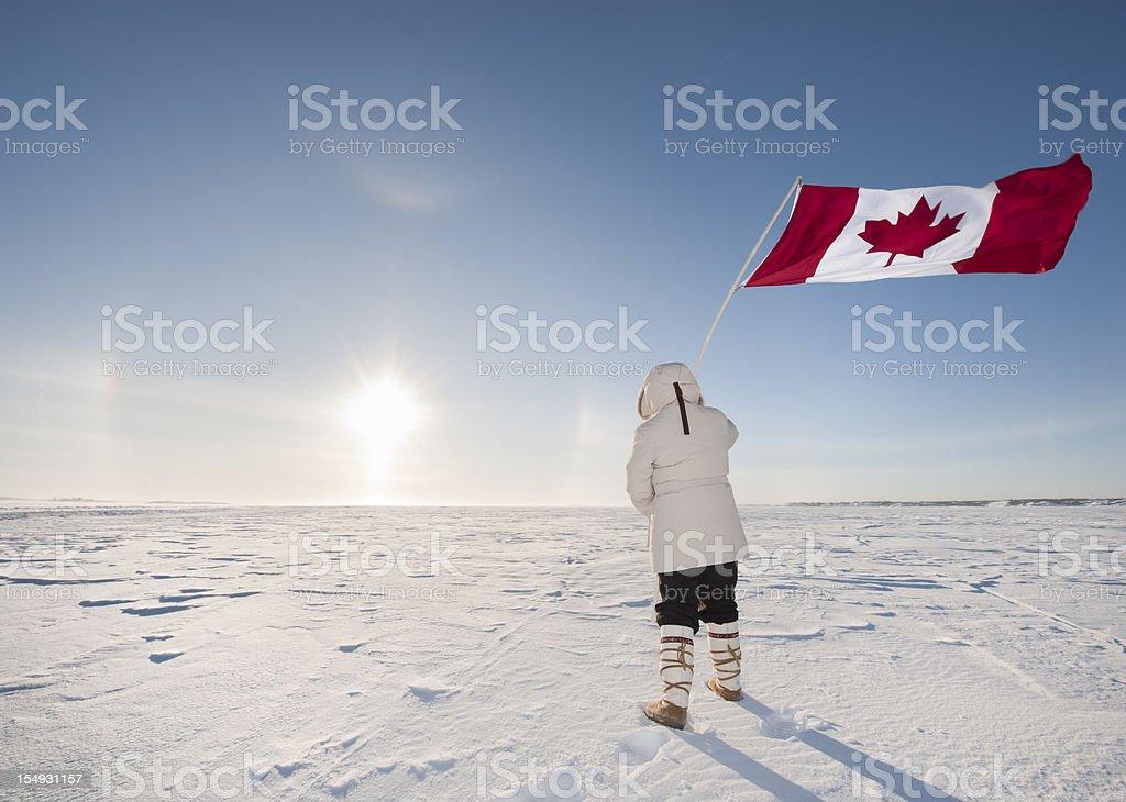 Arctic Sundog or Parhelion, Woman and Canadian Flag. stock photo