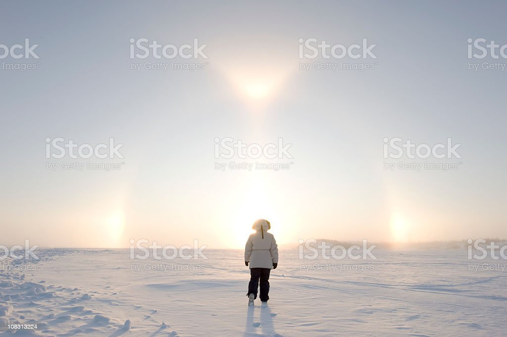 Arctic Sundogs or Parhelion with Woman in parka. royalty-free stock photo