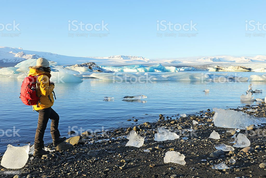 Arctic Traveller Standing at Jokulsarlon Glacial Lagoon in Iceland stock photo
