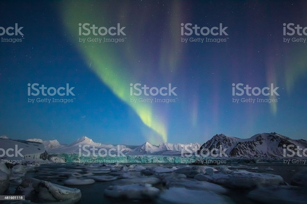 Arctic winter in south Spitsbergen. Aurora borealis over the glacier. stock photo