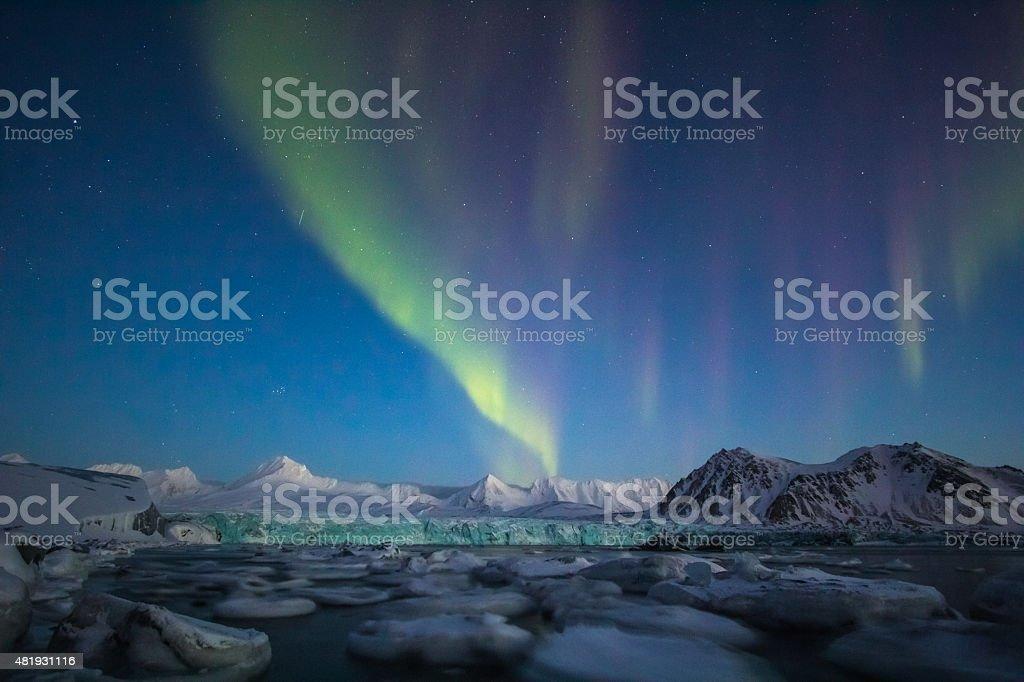 Arctic winter in south Spitsbergen. Aurora borealis over the glacier. stock photo