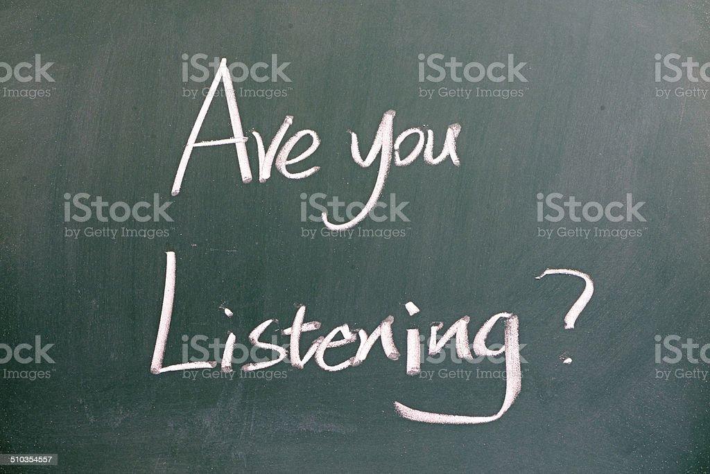 Are you listening written on blackboard stock photo
