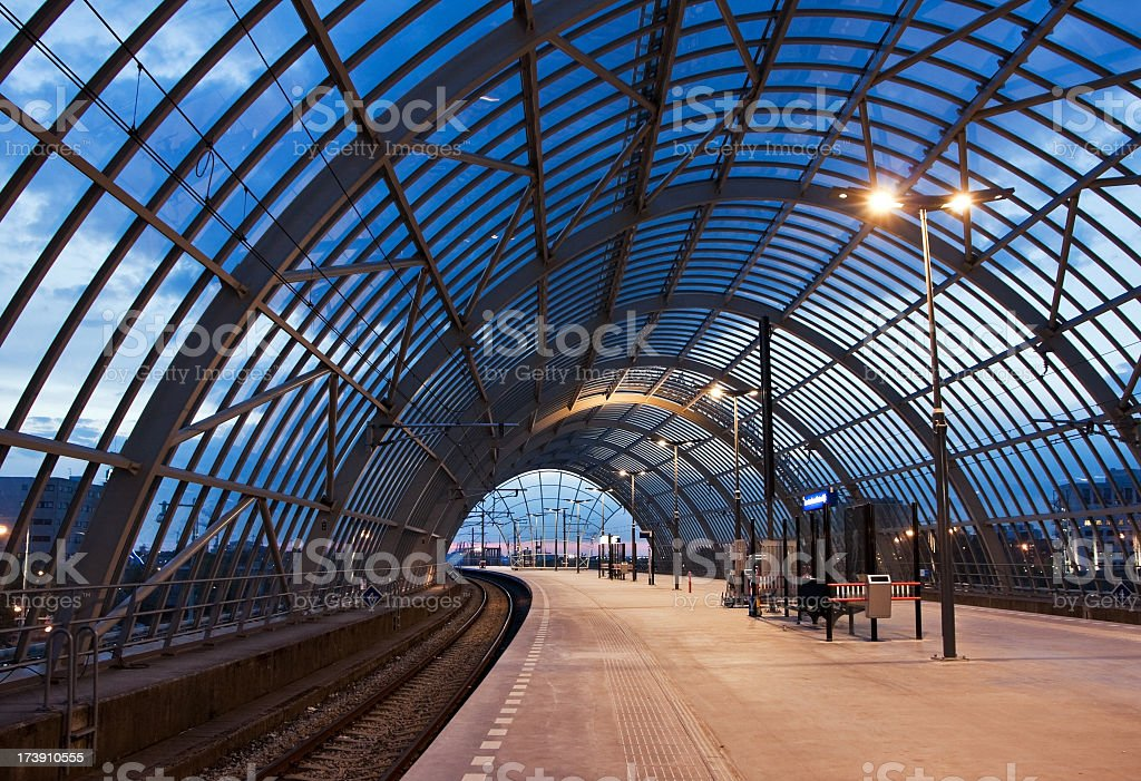 Area inside an empty railroad station at dusk stock photo