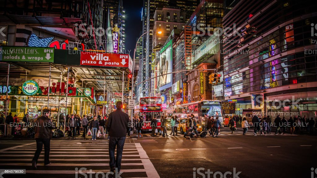 Area near Times Square at night. Times Square is a major commercial intersection and a neighborhood in Midtown Manhattan, New York City. stock photo