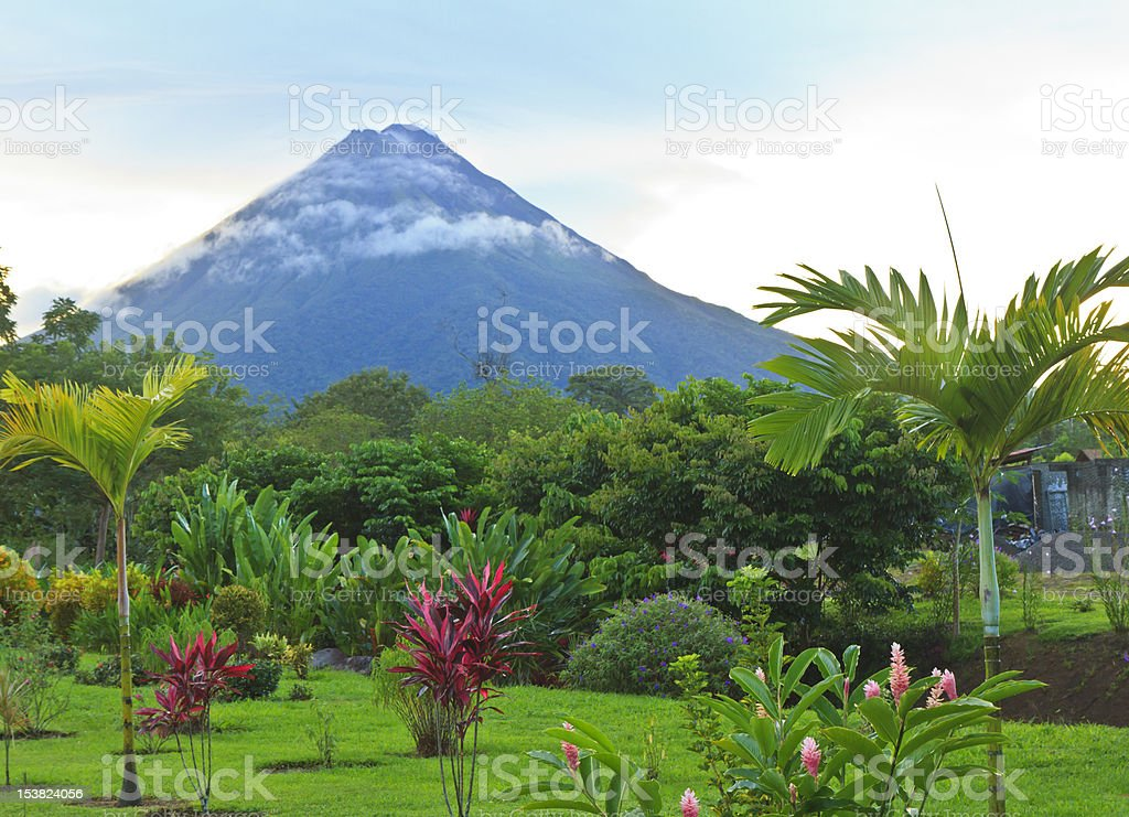 Arenal Volcano in wispy clouds stock photo