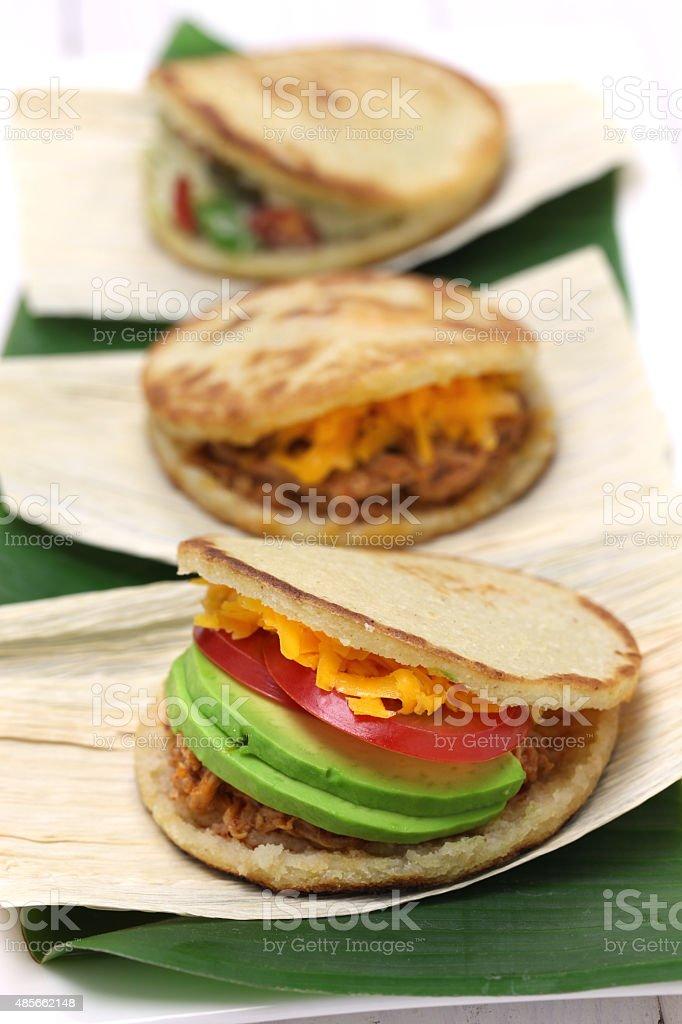arepas, venezuelan colombian corn bread sandwich stock photo