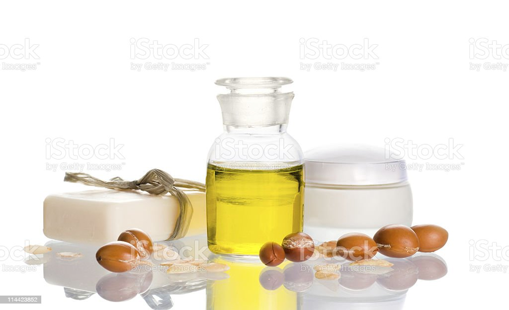 Argan oil with cosmetic products and fruits stock photo