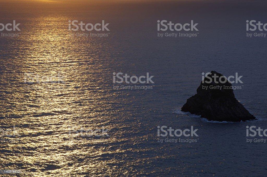 Argentarola Island with sunset reflection royalty-free stock photo