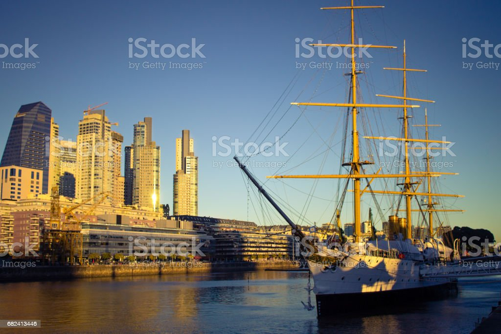 Argentina, Buenos Aires, South America - Frigate Sarmiento with buildings in the background at sunset in Puerto Madero. stock photo