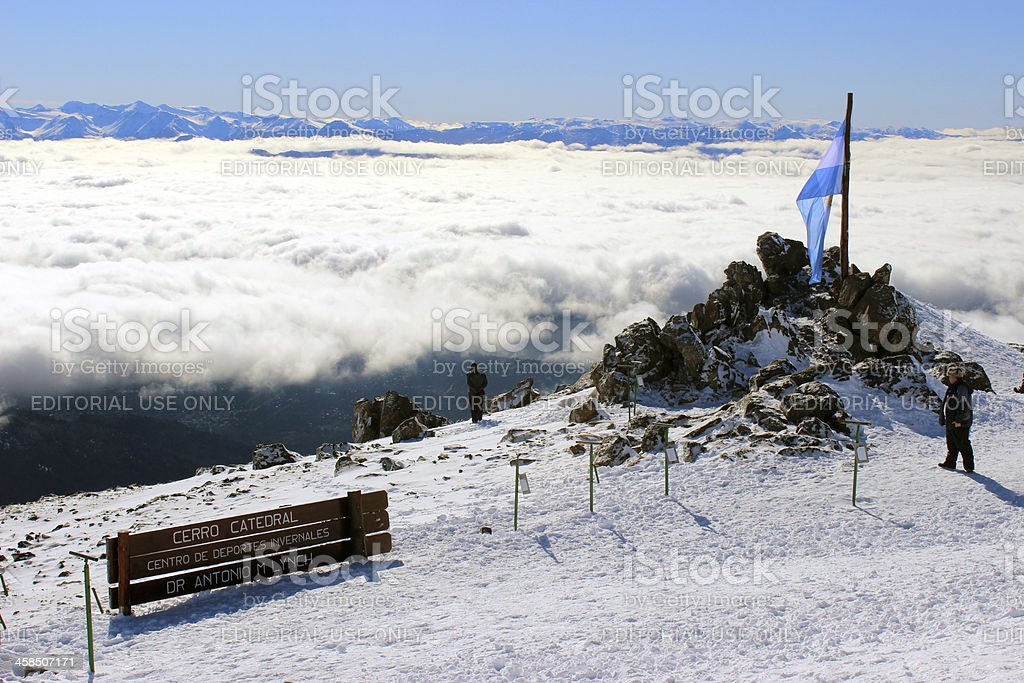 Argentina Flag and Tourists at Andes mountains - Patagonia stock photo