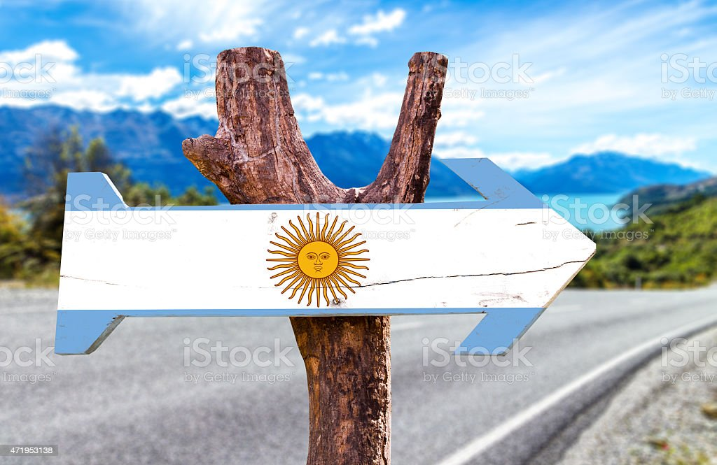 Argentina wooden sign with a road background stock photo