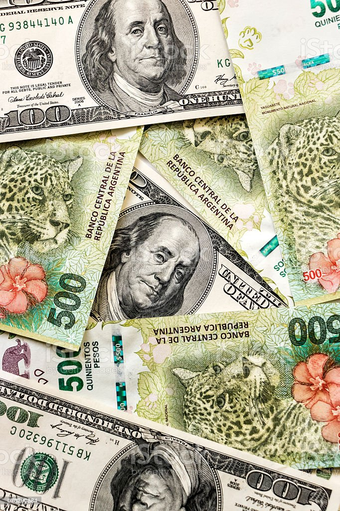 Argentine and US banknotes stock photo