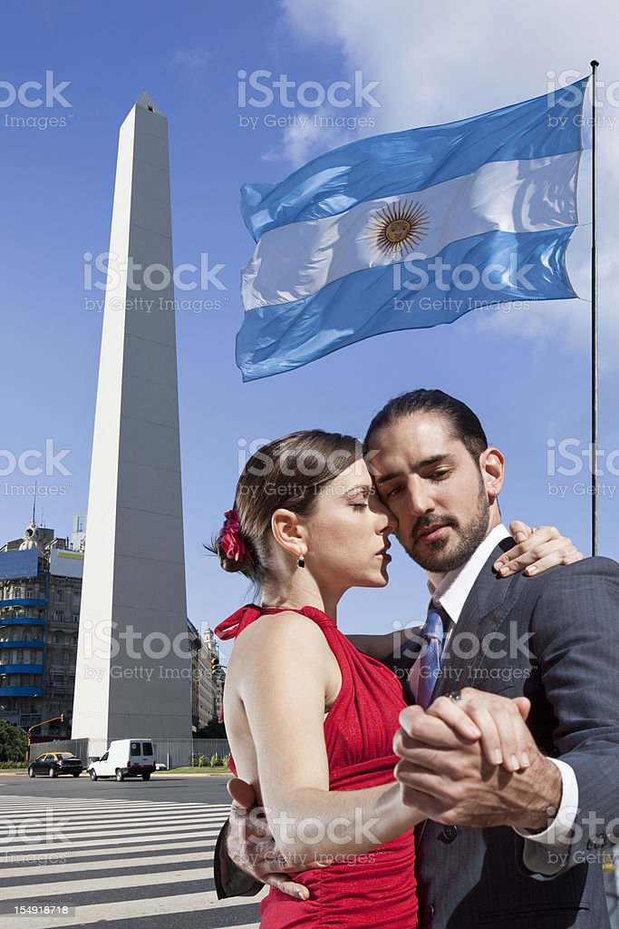 Argentine couple dancing tango in Buenos Aires with Obelisk stock photo