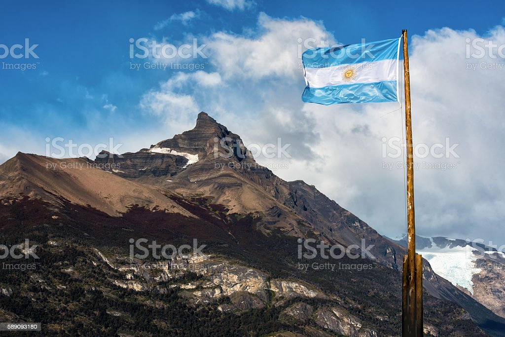 Argentine flag flying in front of the mountain Cerro Moreno stock photo