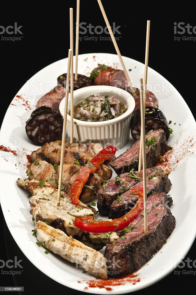 Argentinean assorted meat appetizer Platter stock photo