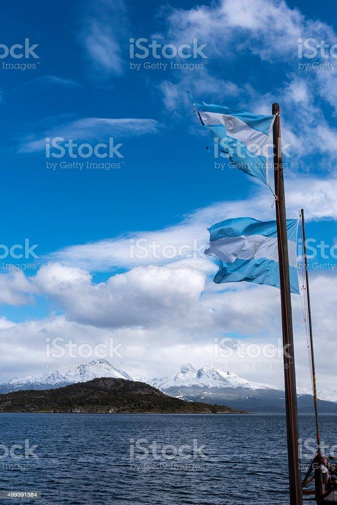 Argentinia Flag flies over Tierra Del Fuego National Park stock photo