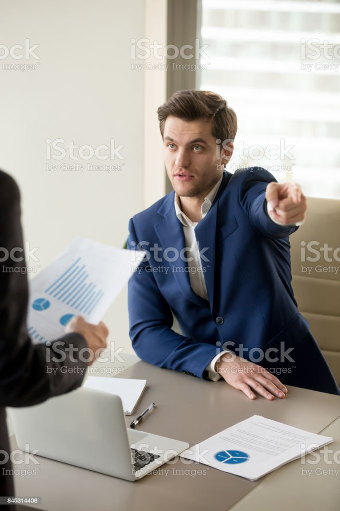 CEO arguing because of mistake in financial report stock photo