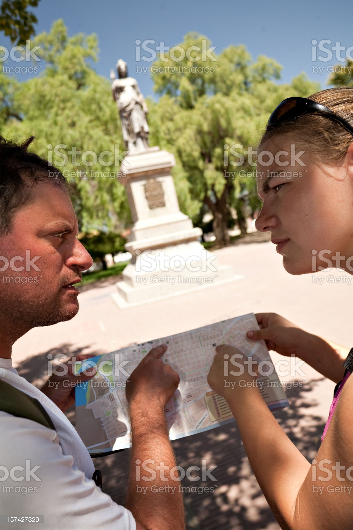 Arguing Over the Map royalty-free stock photo