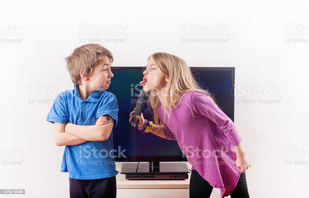 Arguing over the remote control stock photo