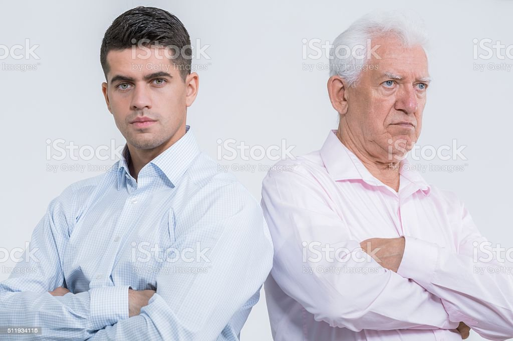 Argument between son and father stock photo