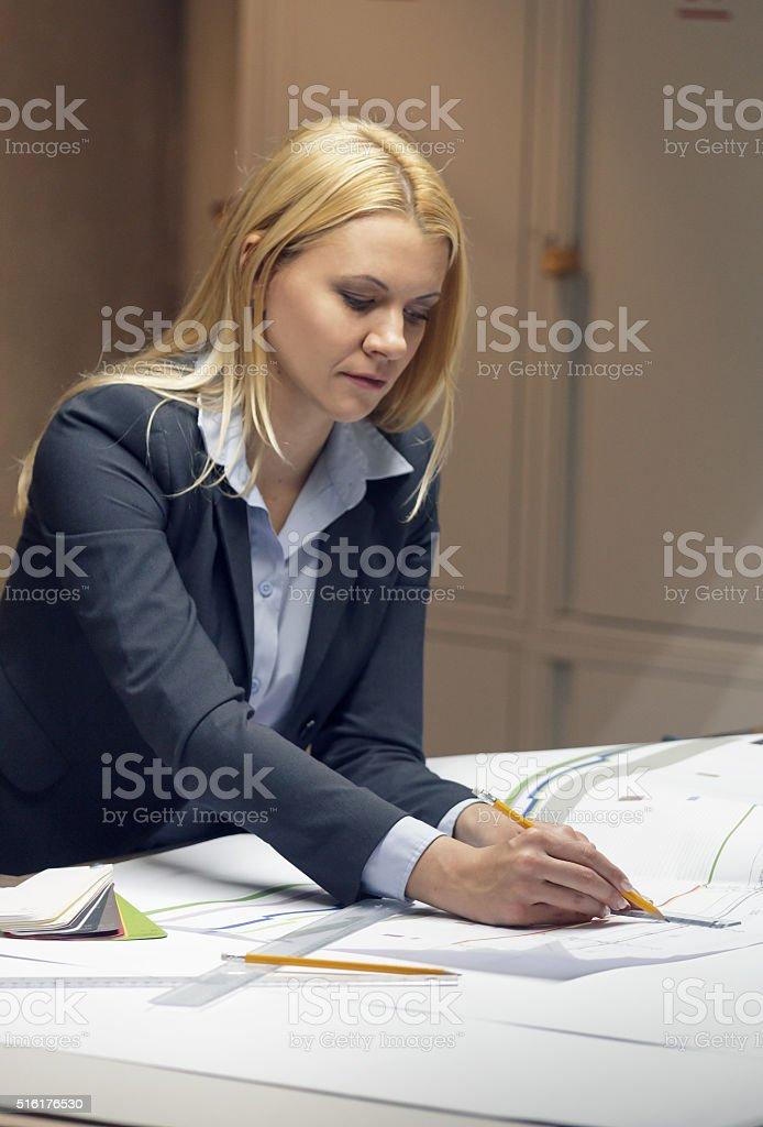 Arhitect working on printout stock photo
