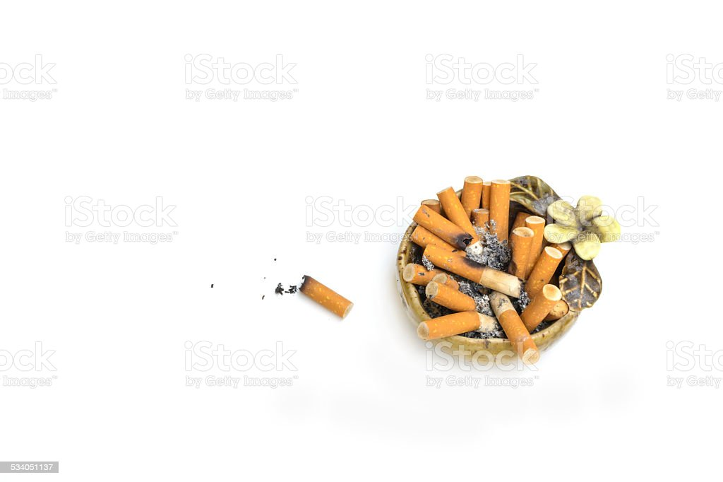 Arhtray with full of cigarettes stock photo