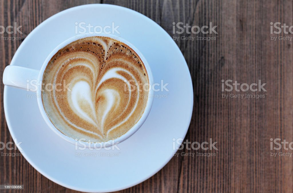 Arial view of coffee with heart shaped foam on wood royalty-free stock photo