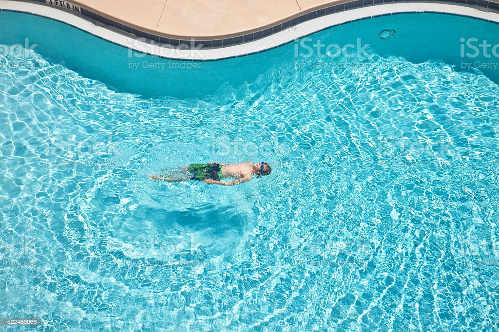 Arial View Of Young Boy Swimming stock photo
