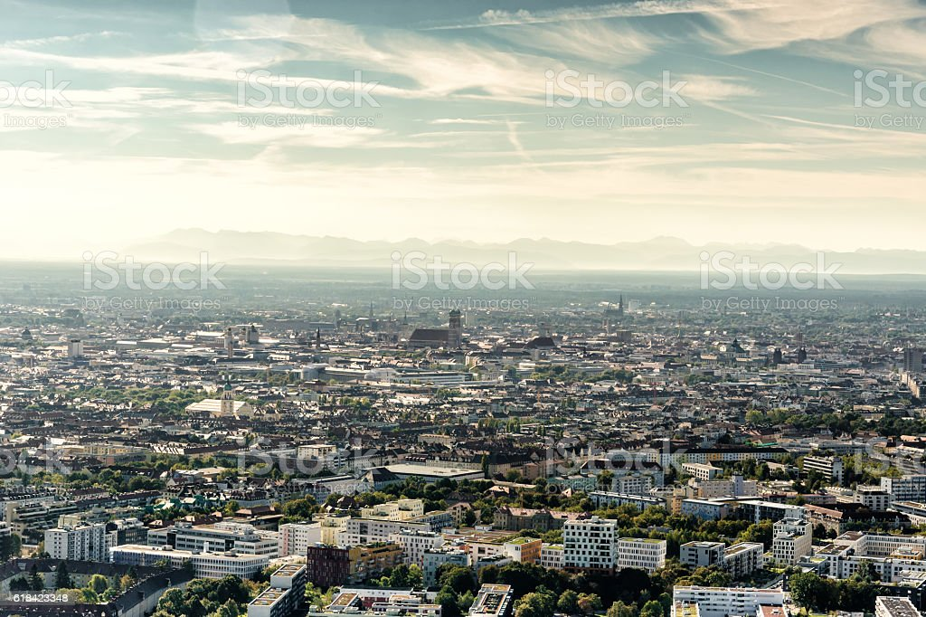 arial view over munich with Frauenkirche and mountain range stock photo