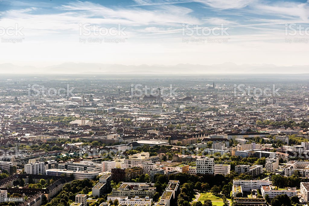 arial view over munich with Frauenkirche and mountains stock photo
