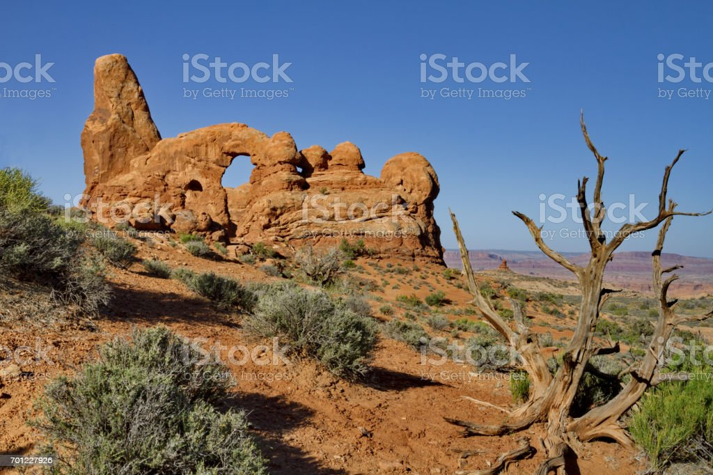 Arid desert landscape surrounding Turret Arch in Arches National Park in Utah stock photo
