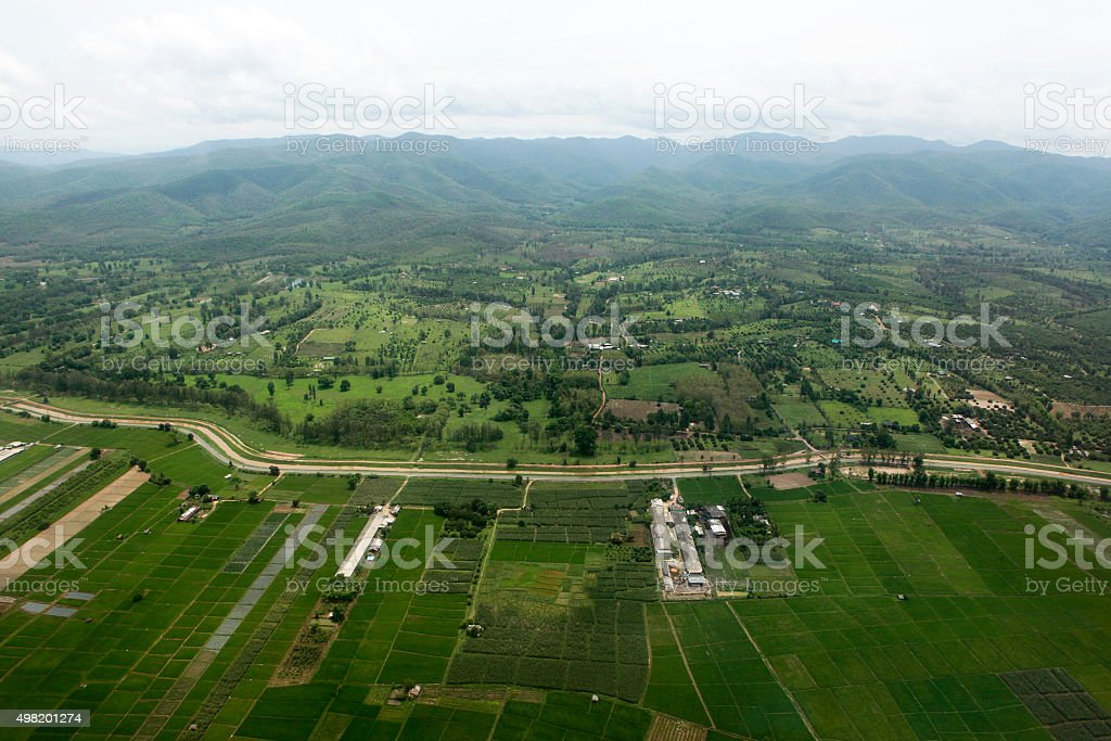 Ariel view of rice field and mountain stock photo