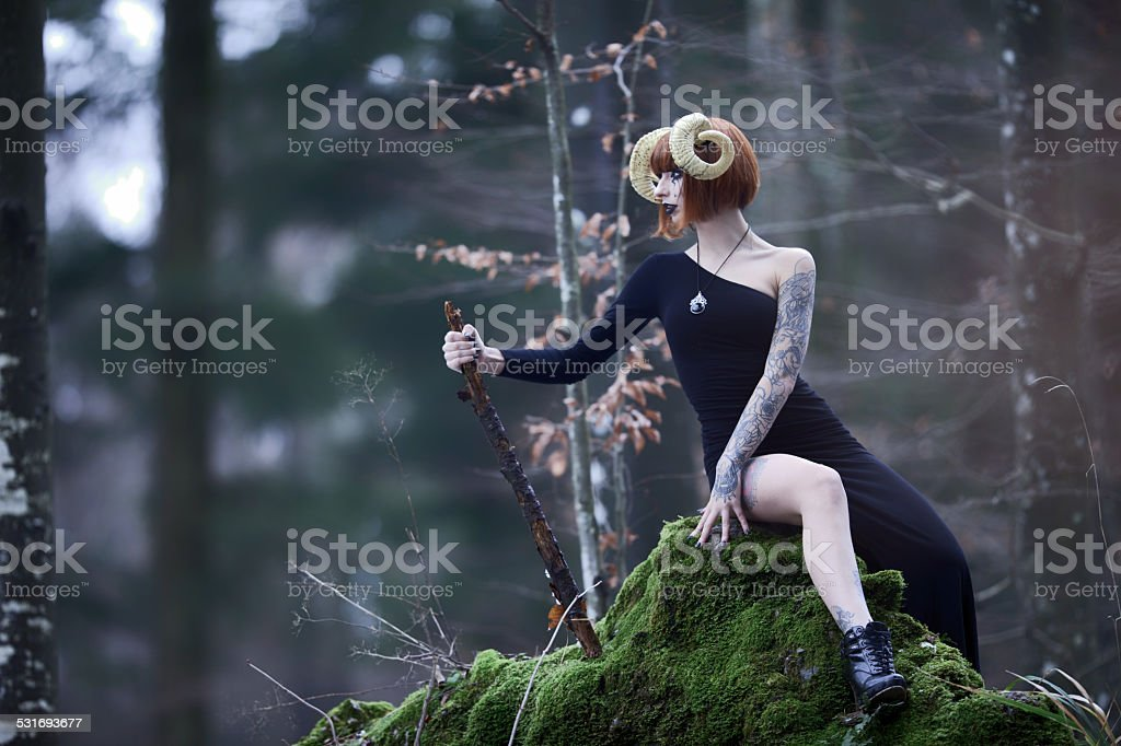 Aries woman portrait in the wild woods stock photo
