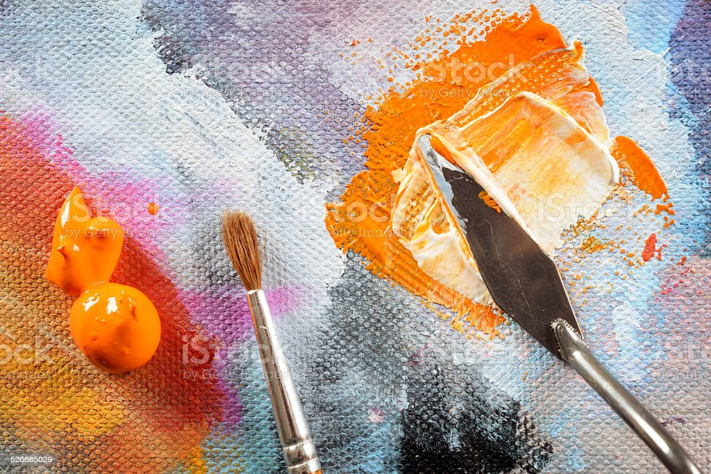 Aristic paint and putty knife stock photo