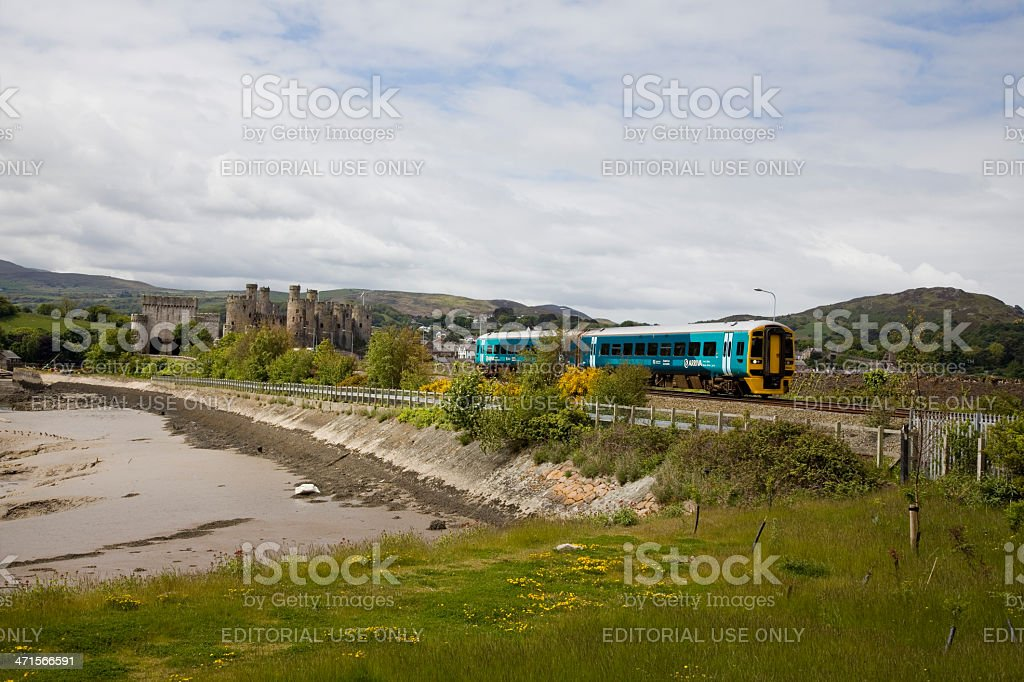 Ariva Trains Wales Train diesel Unit Passes Conwy Castle royalty-free stock photo