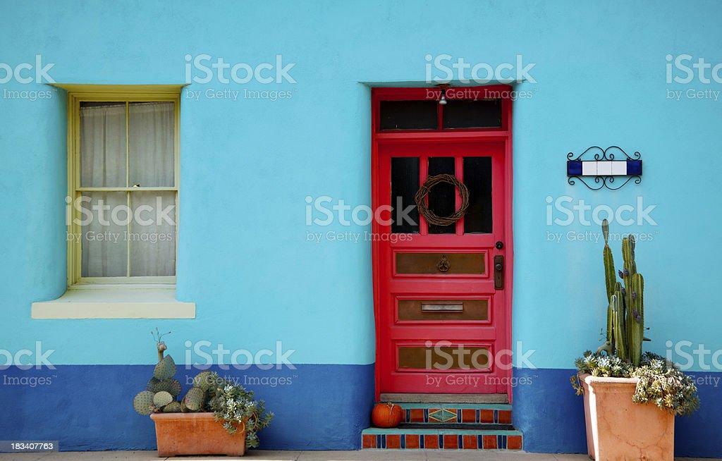 'Arizona, Mexico Blue Stucco Wall and Red Door' stock photo