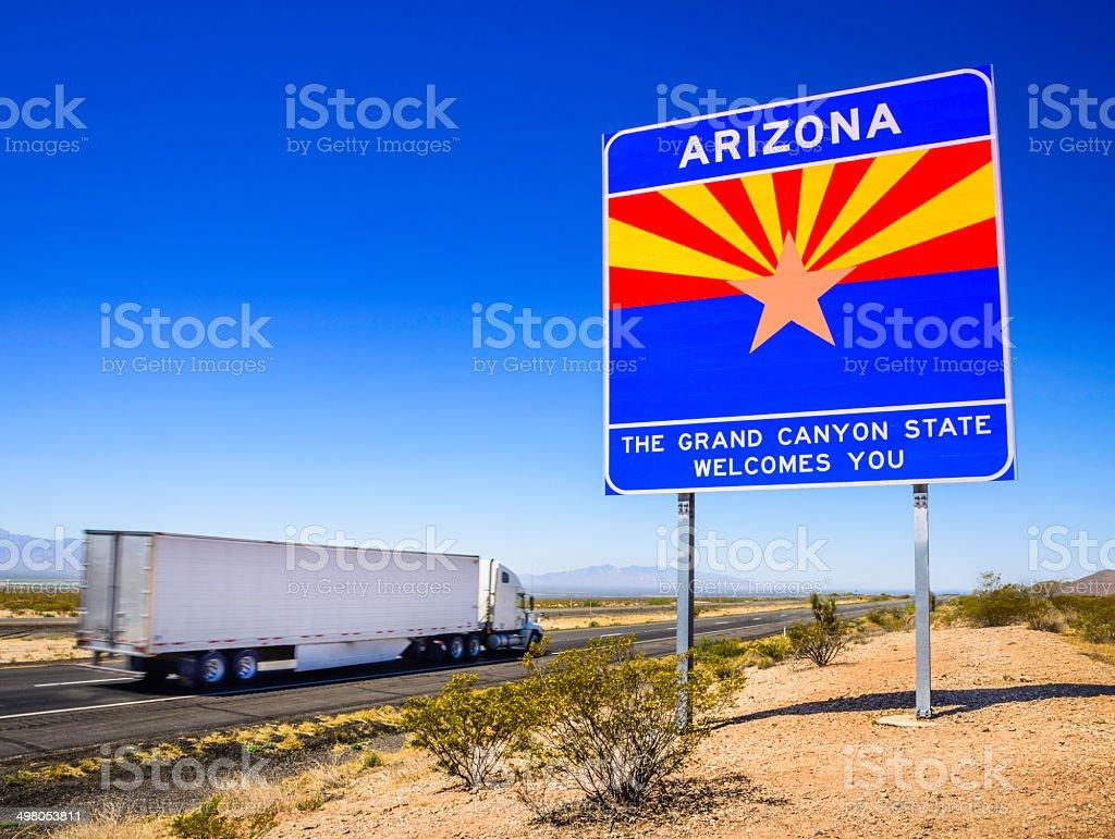 Arizona State line highway sign - 18 wheeler (semi-truck) stock photo