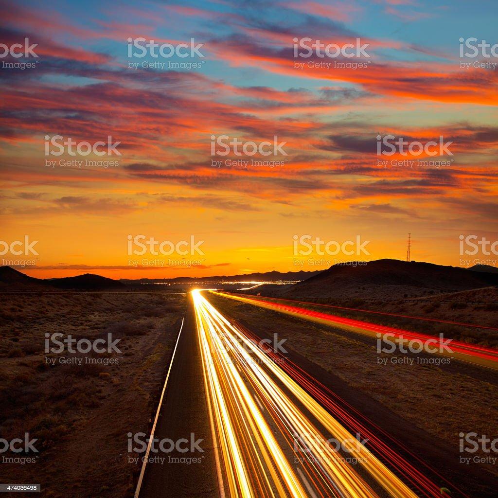 Arizona sunset at Freeway 40 with cars light traces stock photo