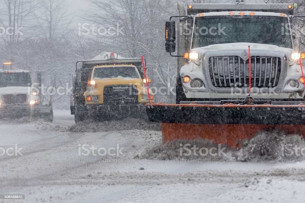 Arlington Virginia, Winter - Trio of snow ploughs stock photo