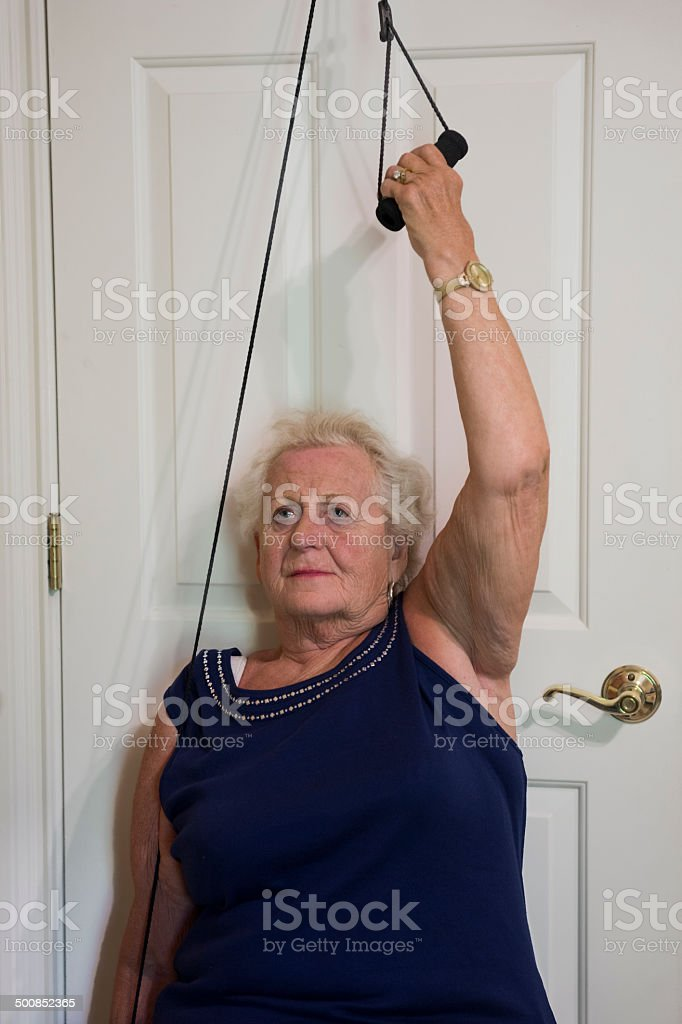 Arm exercises using a pulley stock photo
