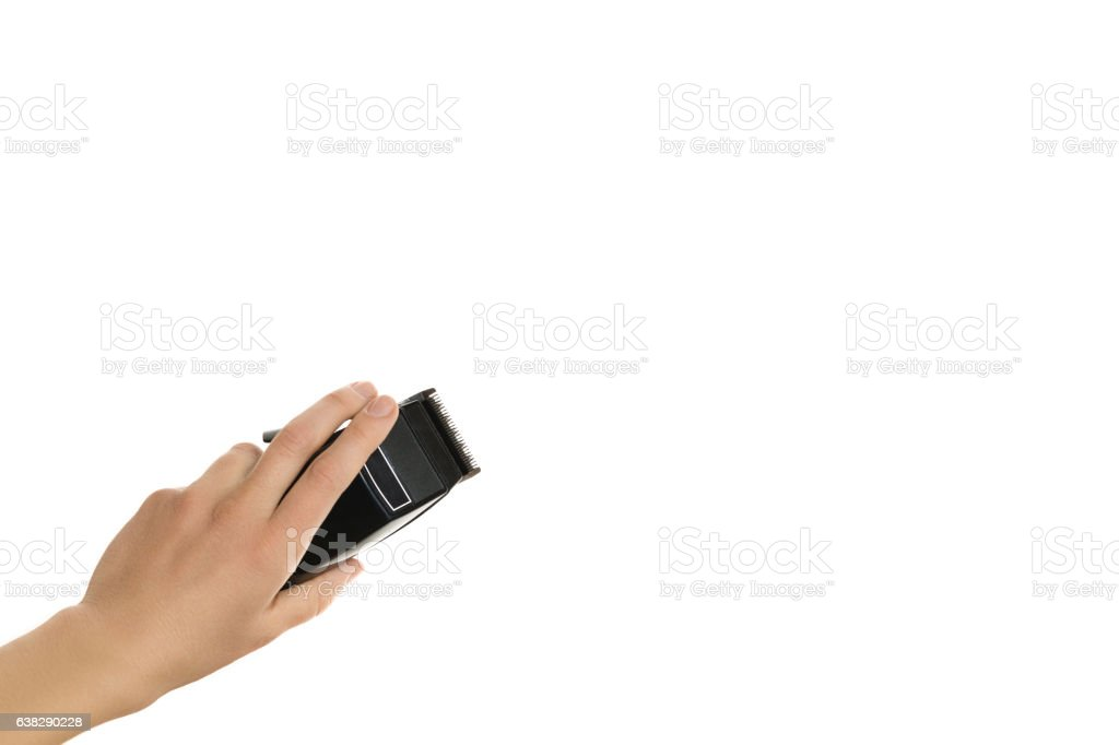 arm holding hairclipper, isolated on white background stock photo