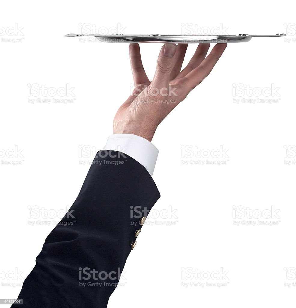Arm holding up a fancy silver tray stock photo