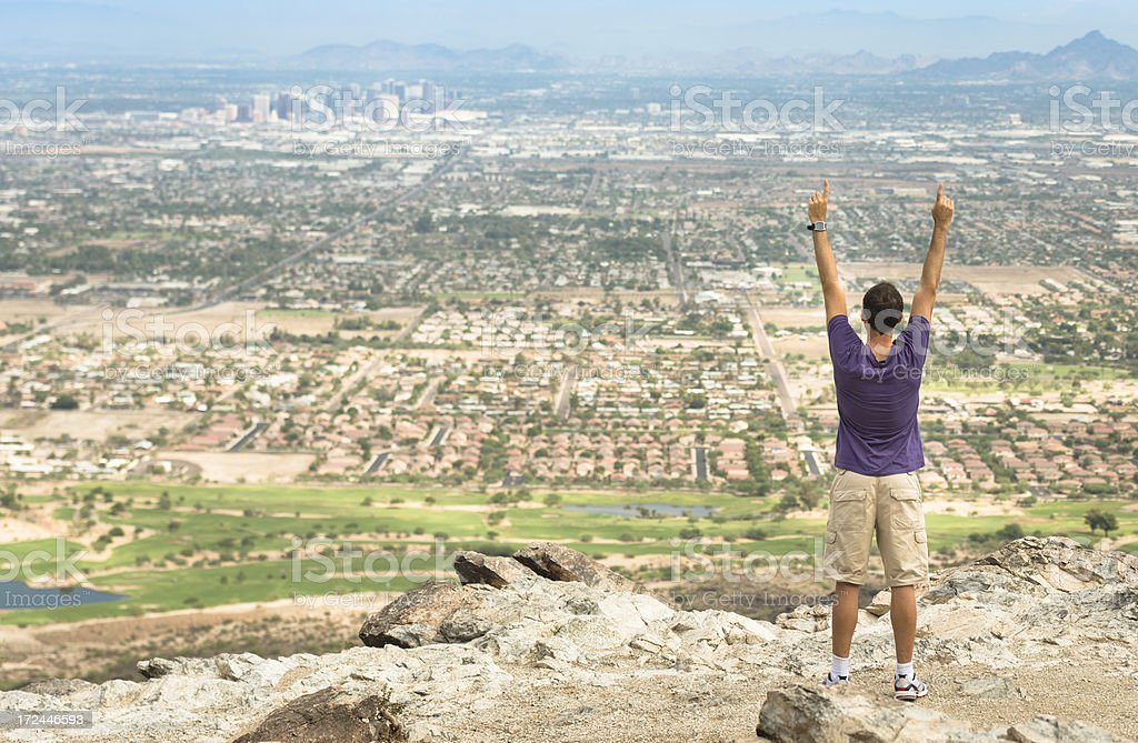 Arm raised against the Phoenix city skyline panorama royalty-free stock photo